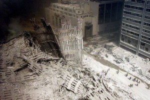 A group of firefighters walk amid rubble near the base of the destroyed south tower of the World Trade Center in New York in this file photo from September 11, 2001. This year's anniversary of the September 11 attacks in New York and Washington will echo the first one, with silence for the moments the planes struck and when the buildings fell, and the reading of 2,792 victims' names. REUTERS/Peter Morgan-Files HB/